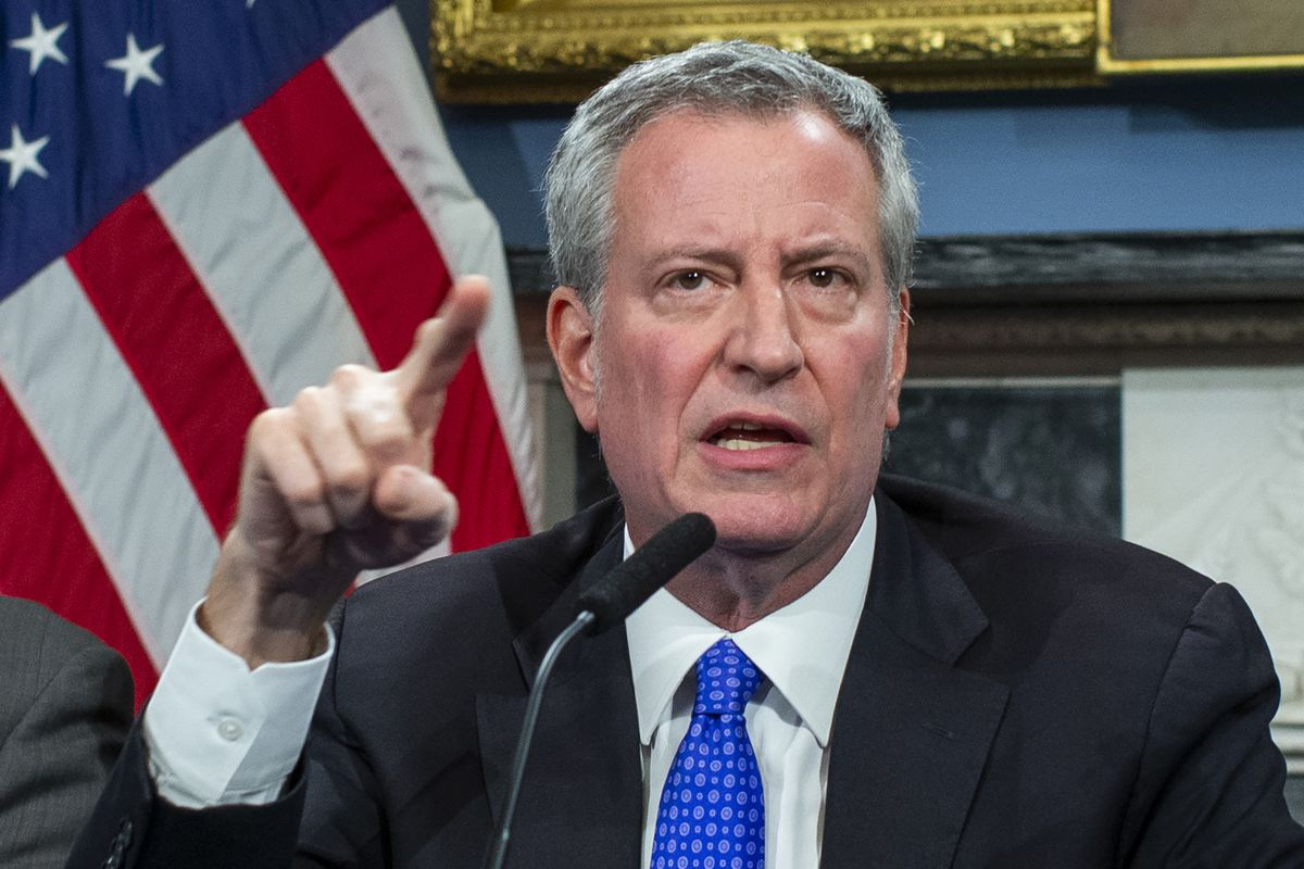 New York City Mayor Bill De Blasio, wearing a suit, speaks during a press conference