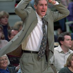 Jazz coach Jerry Sloan tries to explain a call to a referee.