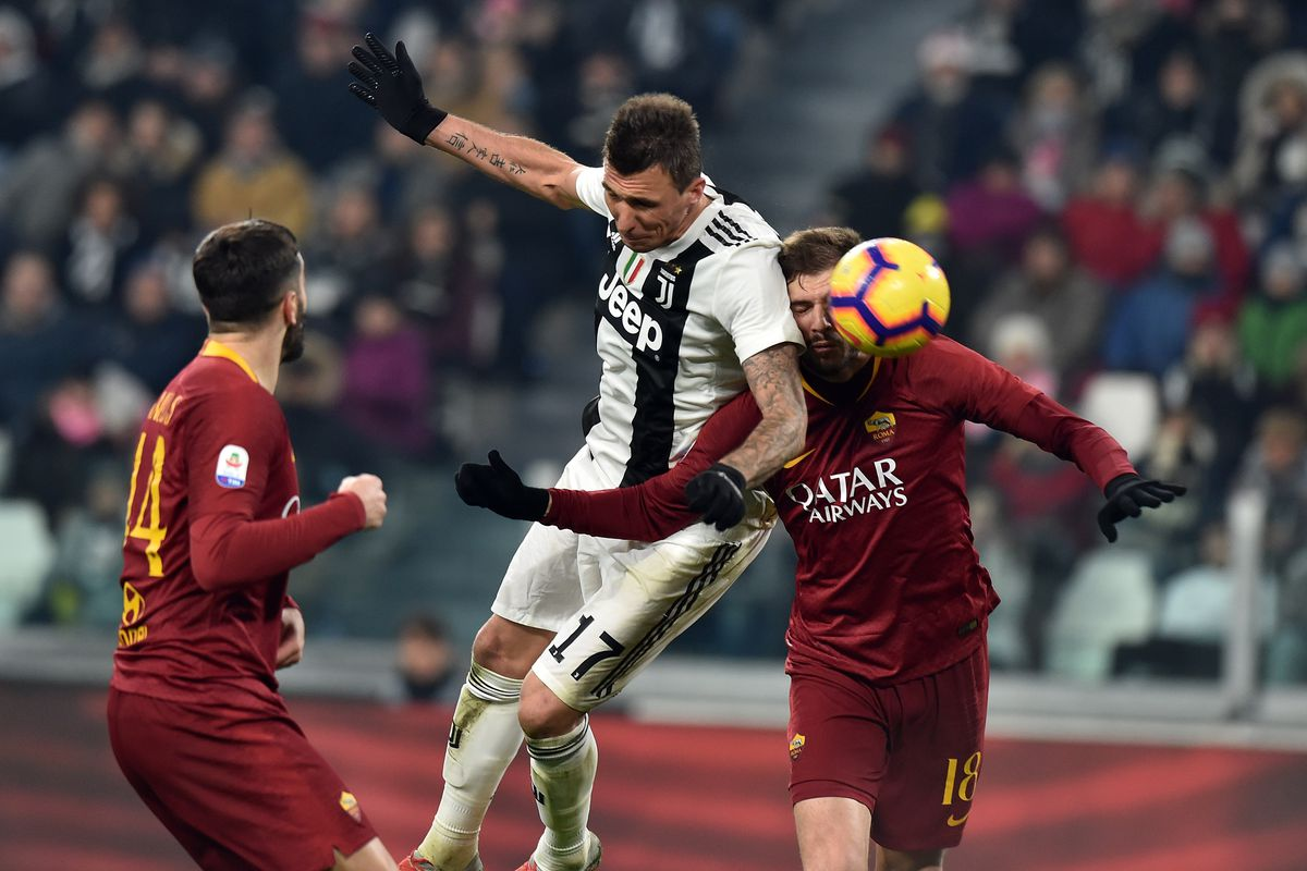 e425276fe Juve hold off Roma to become winter champions - Black   White   Read ...