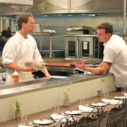 Sous chef Erik Harrelson (right) gives appetizer instructions while standing at the end of the chef's tasting table.