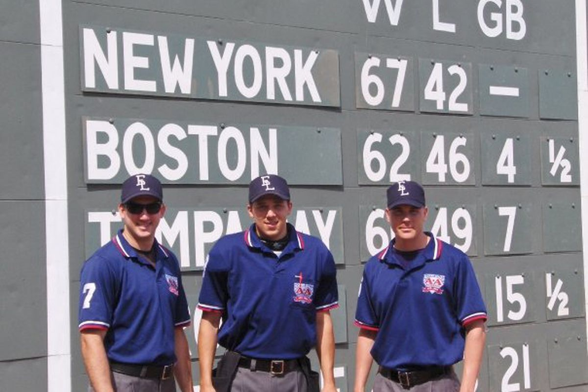 Marquette's Adam Hamari, center, with his 2009 Eastern League umpring crew at Fenway Park. Hamari will be in Anaheim to umpire the Futures Game and assist at the Home Run Derby.