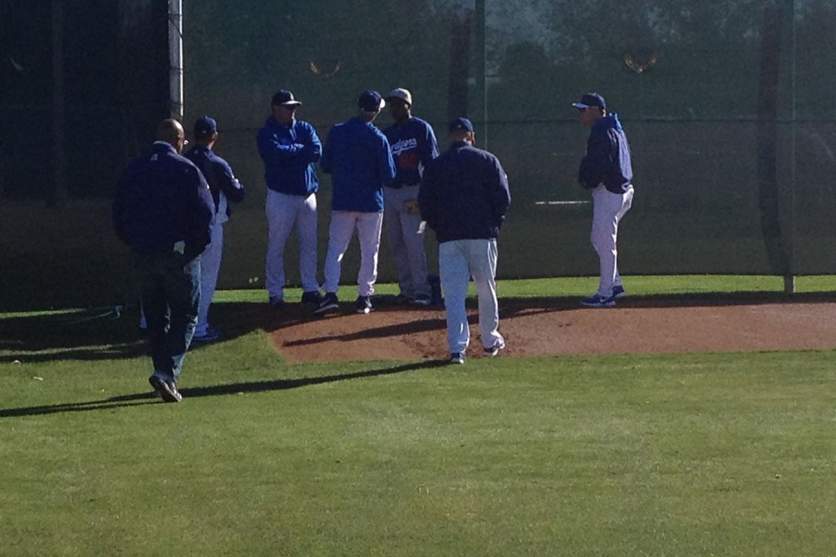 Pedro Baez, getting instruction from Sandy Koufax during spring training in 2013.