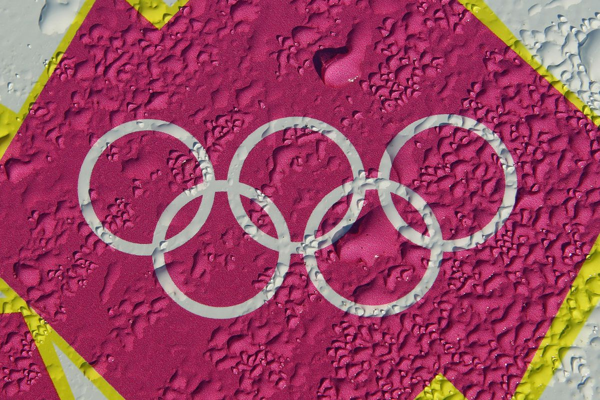 LONDON, ENGLAND - MARCH 19:  Condensation is seen on an Olympic rings logo outside the Olympic Stadium on March 19, 2012 in London, England.  (Photo by Julian Finney/Getty Images)