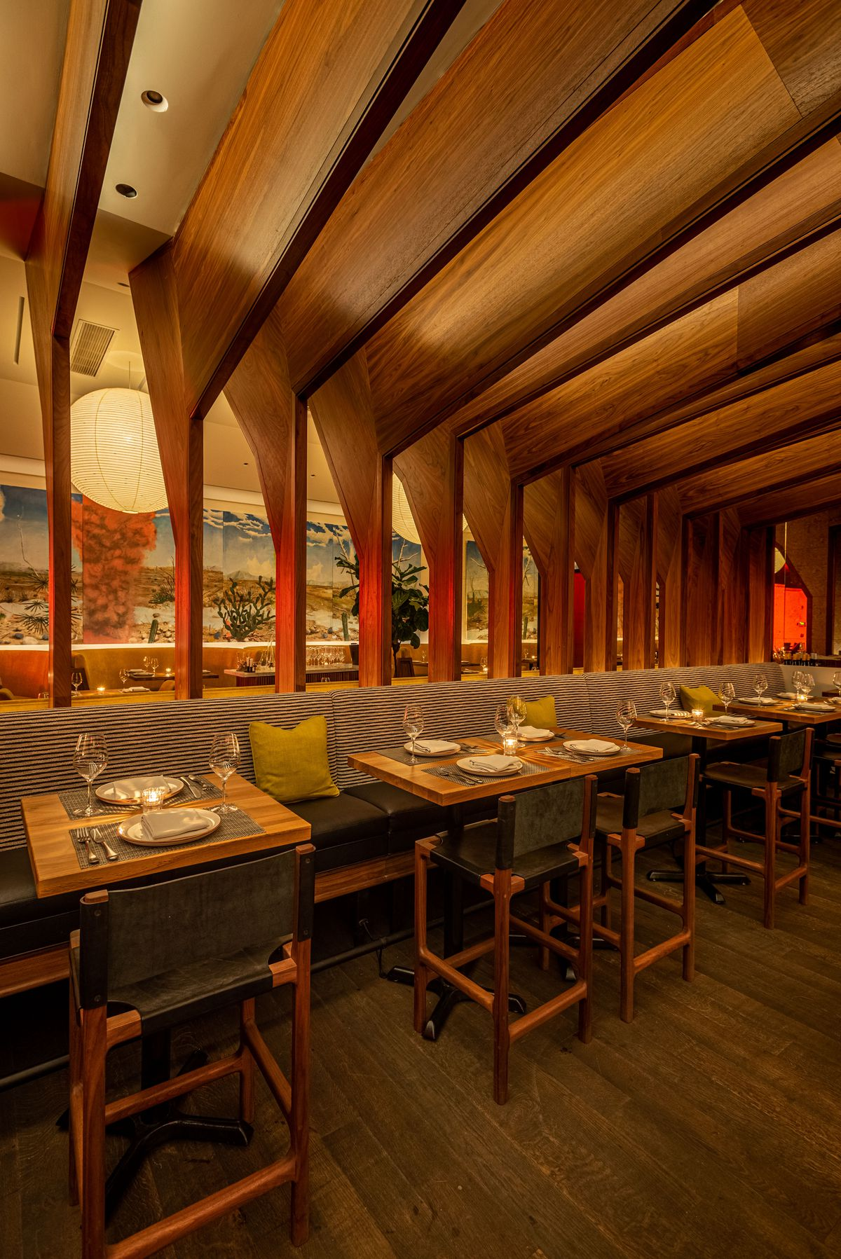 Wooden tables and chairs in a new restaurant at evening.