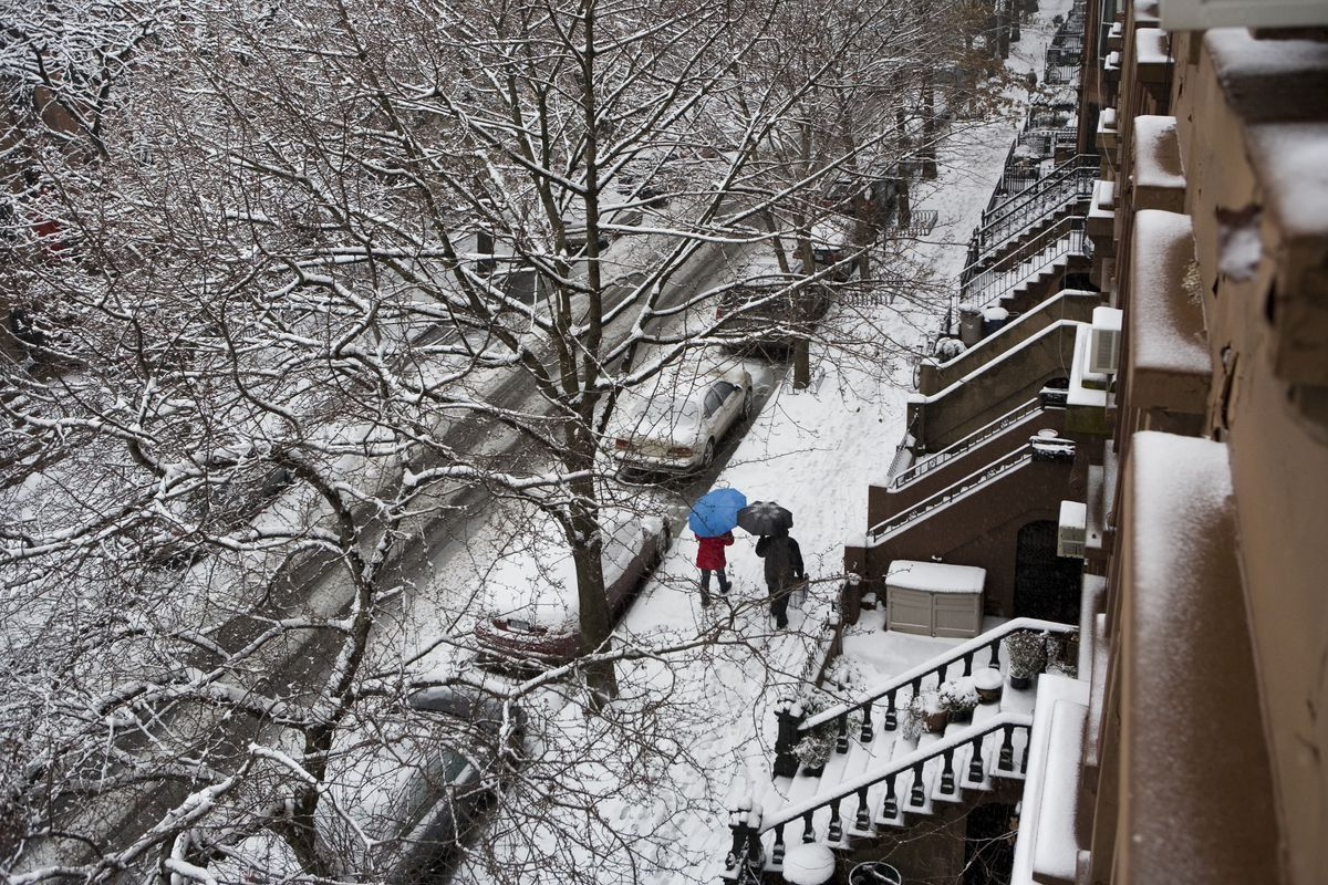 Pedestrians walk in a street in the Prospect Heights neghboorhood of Brooklyn during a snow storm December 19, 2008 in New York City.