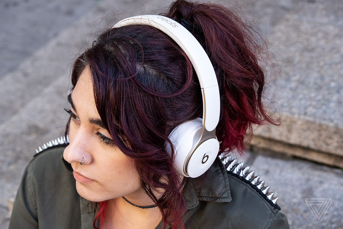 A photo of the Beats Solo Pro headphones, the best on-ear noise-canceling headphones, worn on a woman's head.