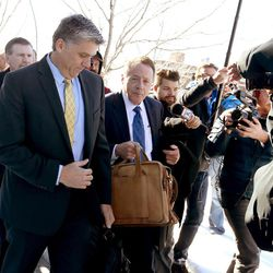 San Juan County Commissioner Phil Lyman, left, leaves the federal courthouse on Friday, Dec. 18, 2015, in Salt Lake City. Lyman was sentenced to 10 days in jail and three years of probation for an illegal ATV protest ride in a southern Utah canyon.