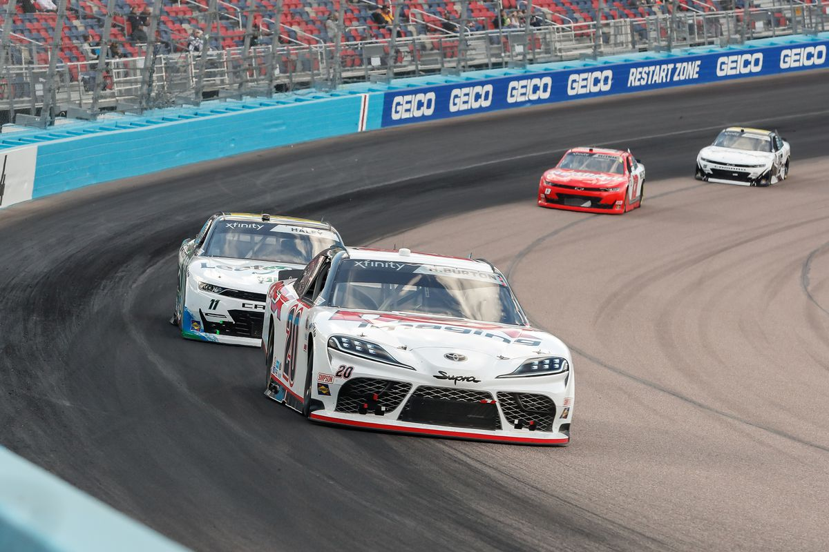 Harrison Burton, driver of the #20 Joe Gibbs Racing DEX Imaging Toyota Supra, leads Justin Haley, driver of the #11 Kaulig Racing LeafFilter Gutter Protection Chevrolet Camaro, during the Call 811 Before You Dig 200 Nascar Xfinity Series Race on March 13, 2021 at Phoenix ISM Raceway in Phoenix, Arizona.