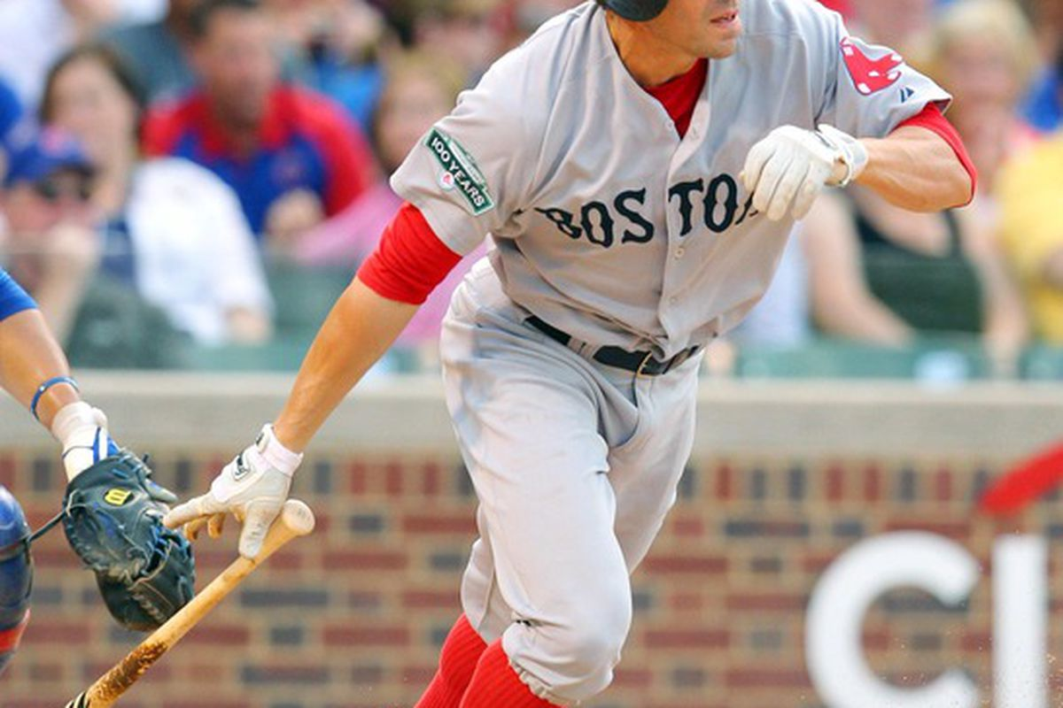 Jun 16, 2012; Chicago, IL, USA; Boston Red Sox outfielder Scott Podsednik (26) hits a single in the third inning against the Chicago Cubs at Wrigley Field. Mandatory Credit: Dennis Wierzbicki-US PRESSWIRE