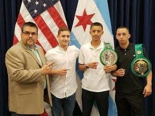 """Winning boxers emerged from the Chicago Youth Boxing Club in the basement of Pastor Victor Rodriguez's La Villita Community Church. (From left) """"Pastor Vic,"""" Felix Gonzalez, Omar Perez and George Perez. 