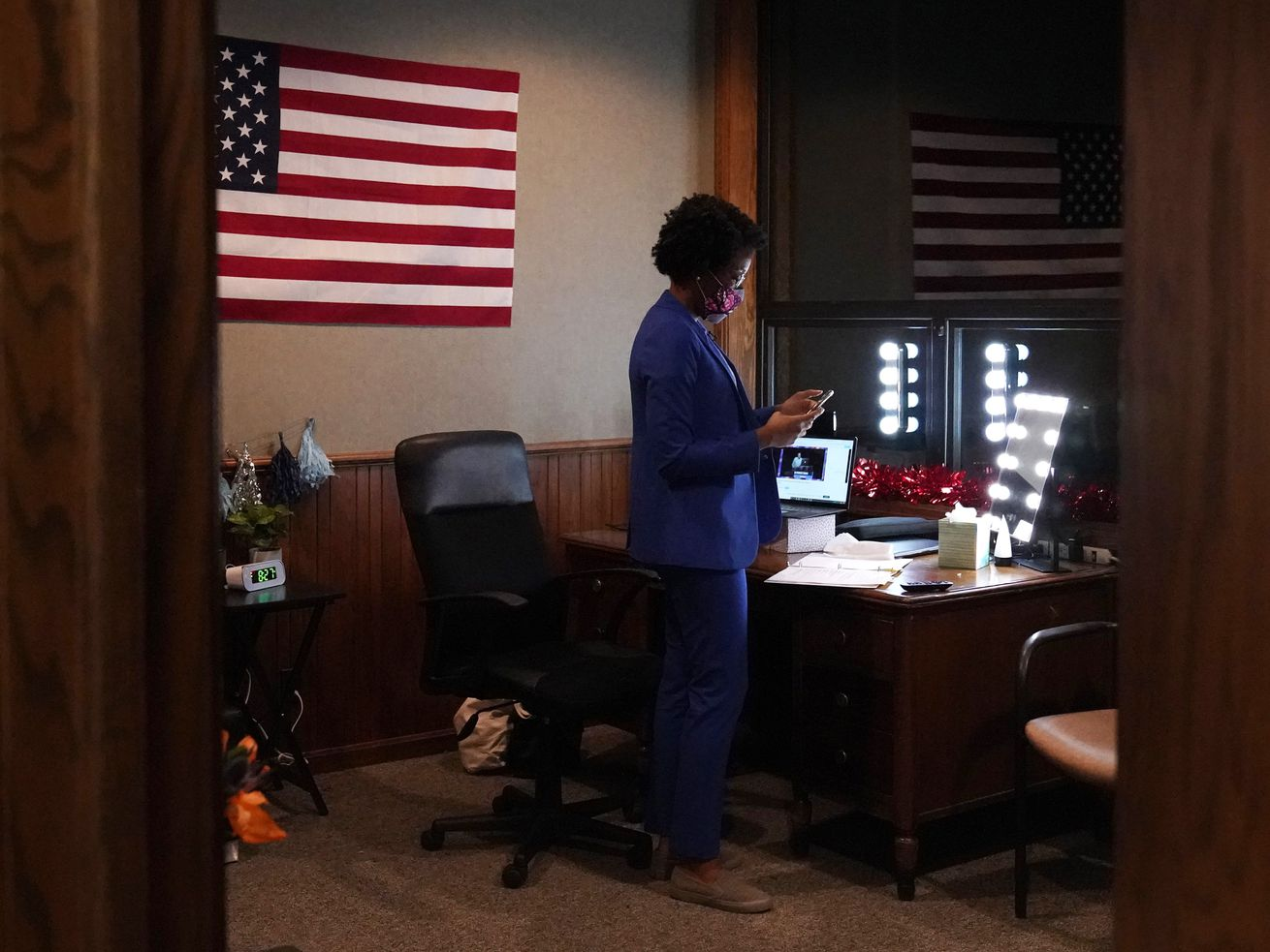 Congresswoman Lauren Underwood checks her phone at an election night headquarter in St. Charles, Ill., Tuesday, Nov. 3, 2020. Lauren Underwood of Naperville and Jim Oberweis of Sugar Grove are the candidates for the 14th U.S. Congressional District seat. (AP Photo/Nam Y. Huh) ORG XMIT: ILNH101