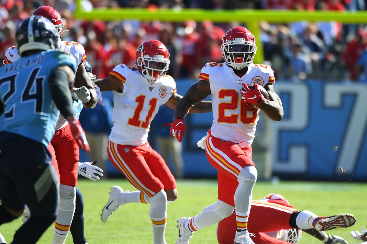 Kansas City Chiefs running back Damien Williams runs for a short gain against the Tennessee Titans during the first half at Nissan Stadium.