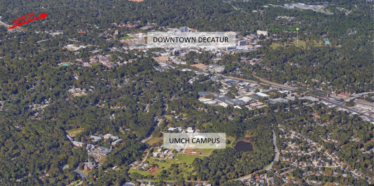 An aerial view showing the large, green campus in relationship to downtown Decatur, just to the northwest.