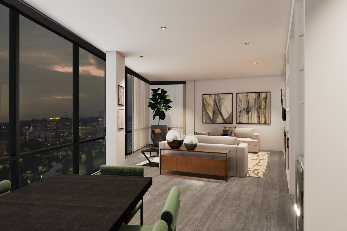 A white living room in a condo with many windows.