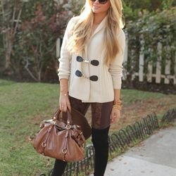 """Sophie of <a href=""""http://angelfoodstyle.com""""target=""""_blank"""">Angel Food Style</a> is wearing a Maje sweater, BCBG leggings, <a href=""""http://www.stuartweitzman.com/products/highland/?DepartmentId=455&DepartmentGroupId=-1&utm_source=CJ&utm_medium=AFF&utm_co"""
