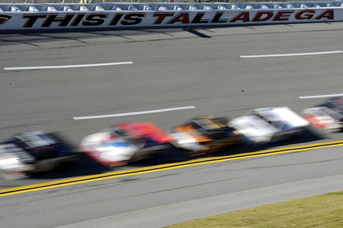 TALLADEGA AL - OCTOBER 30: Trucks race during the NASCAR Camping World Truck Series Mountain Dew 250 at Talladega Superspeedway on October 30 2010 in Talladega Alabama.  (Photo by John Harrelson/Getty Images for NASCAR)