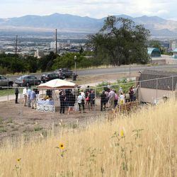 The dedication of the Popperton Plots community garden takes place in Salt Lake City on Friday, Aug. 22, 2014.