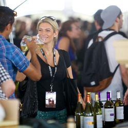 Festival-goers taste wine at Butler Park's Grand Tasting Tent // photo by Patrick Michels