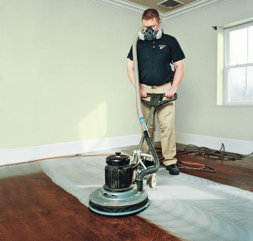 Man Buffering Hardwood Floor