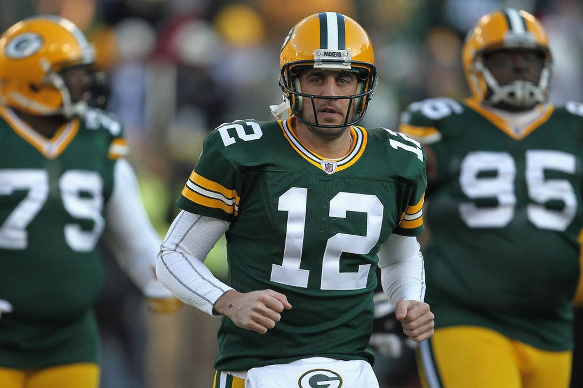 GREEN BAY, WI - DECEMBER 11: Aaron Rodgers #12 of the Green Bay Packers participates in warm-ups before a game against the Oakland Raiders at Lambeau Field on December 11, 2011 in Green Bay, Wisconsin. (Photo by Jonathan Daniel/Getty Images)