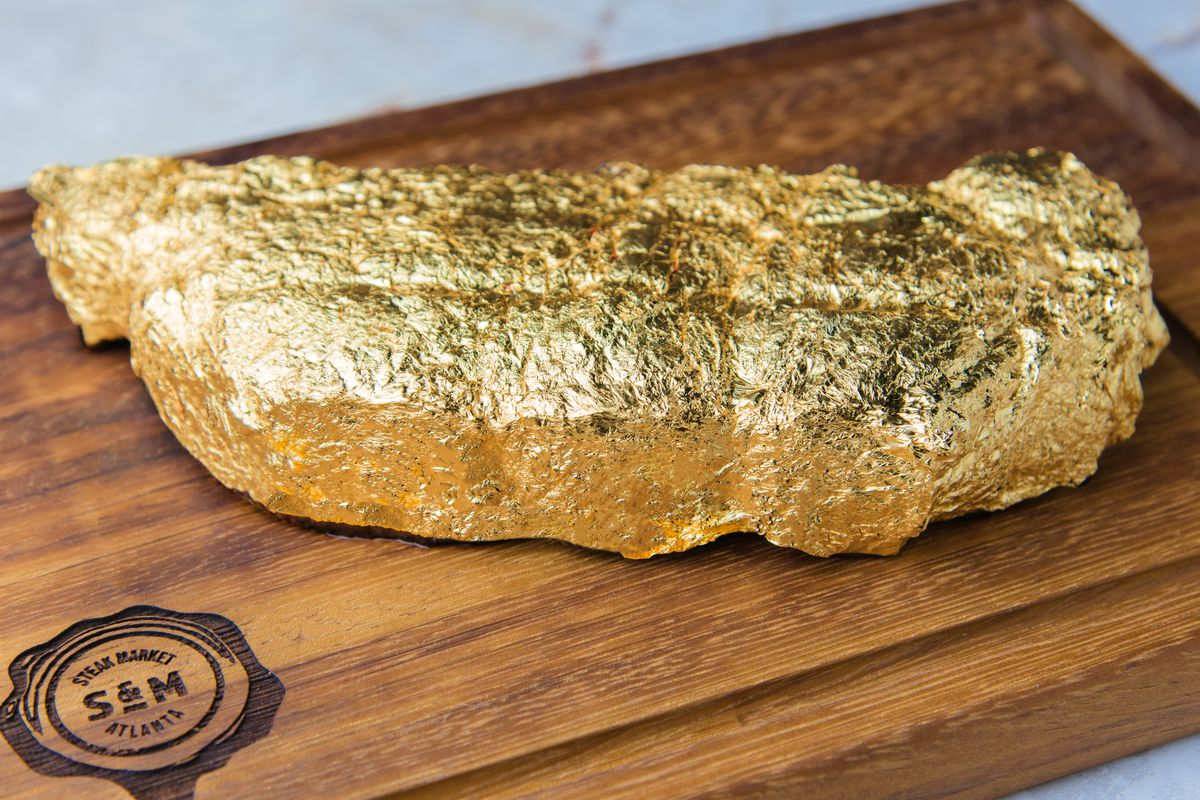 Gold-leaf foil-encrusted steak at Steak Market in Atlanta