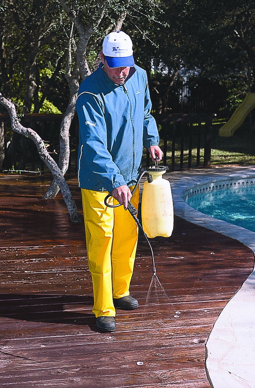<p><strong>1. Clean</strong> Wet the wood with water from a hose or a power-washer tip held at least 18 inches from the surface. (A wet deck disperses the cleaning solution evenly.) Mix the deck cleaner according to the directions on the container and apply it to the wet wood with a pump sprayer. Wait about 10 minutes for the cleaner to work.</p>