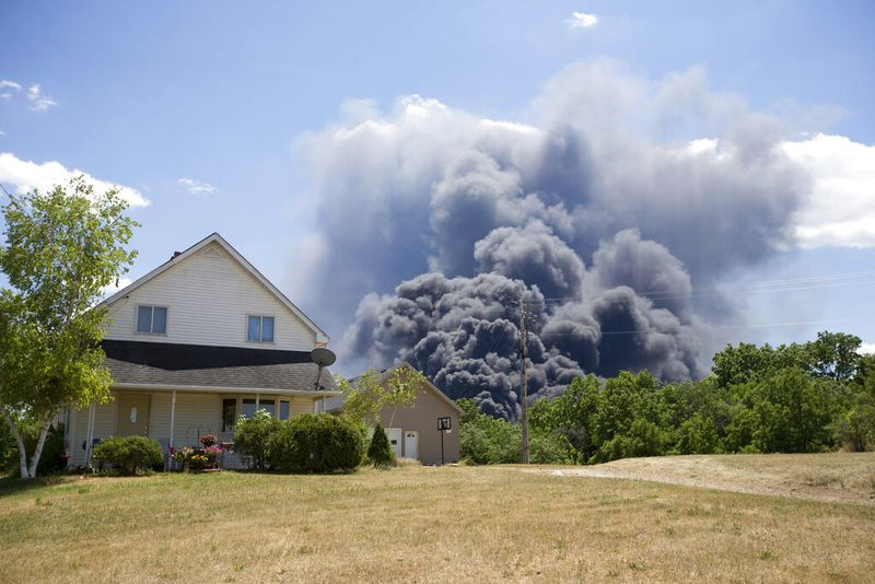 A black smoke cloud from the massive industrial fire at Chemtool Rockton billows over a house on S. Bluff Road Monday, June 14, 2021