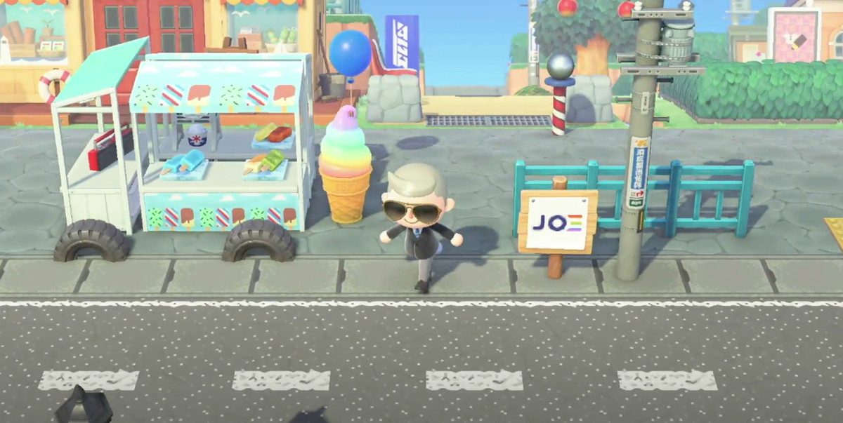 screenshot of Joe Biden's Animal Crossing avatar on a streetscape including an ice cream truck and campaign signs