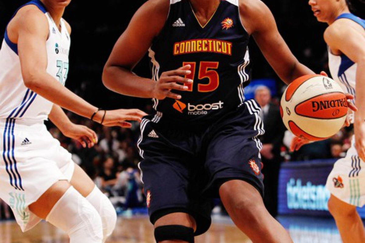 May 19, 2012; New York, NY, USA; Connecticut Sun forward Asjha Jones (15) dribbles the ball as New York Liberty forward Plenette Pierson (33) defends during the first half at Madison Square Garden. Mandatory Credit: Debby Wong-US PRESSWIRE