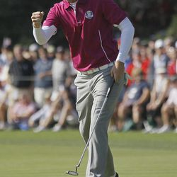 Europe's Nicolas Colsaerts reacts after making a birdie putt on the 11th hole during a foursomes match at the Ryder Cup PGA golf tournament Saturday, Sept. 29, 2012, at the Medinah Country Club in Medinah, Ill.