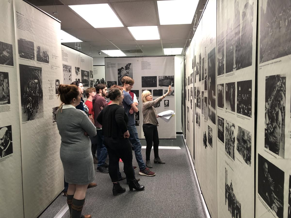 """A docent leads a tour through the """"Anne Frank in the World"""" Exhibit."""