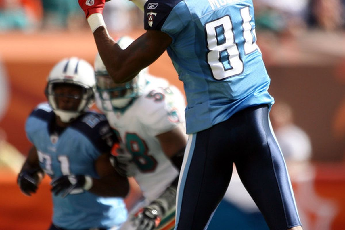 MIAMI - NOVEMBER 14:  Wide receiver Randy Moss #84 of the Tennessee Titans makes a catch against the Miami Dolphins at Sun Life Stadium on November 14 2010 in Miami Florida.  (Photo by Marc Serota/Getty Images)