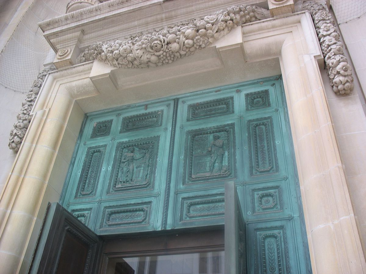 A view of the turquoise bronze panels above the grand doors.