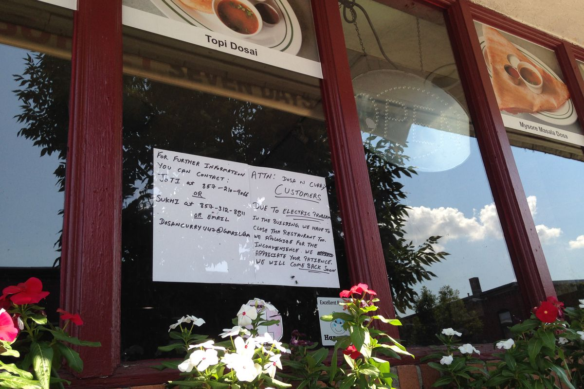 A sign in the window at Dosa N Curry