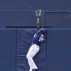 San Diego Padres center fielder Cameron Maybin goes up high at the wall to rob San Francisco Giants' Xavier Nady of a home run during the first  inning of a baseball game Saturday, Sept. 29, 2012 in San Diego.
