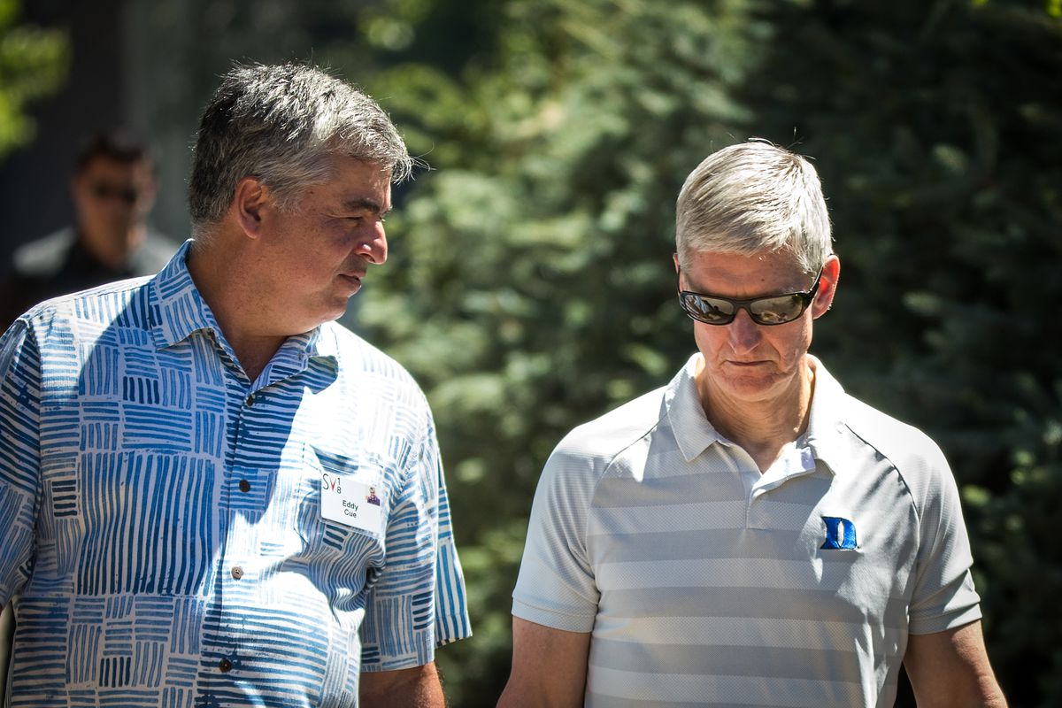 Eddy Cue, senior vice president of Internet Software and Services at Apple, and Tim Cook, chief executive officer of Apple, attend the annual Allen & Company Sun Valley Conference, July 12, 2018. in Sun Valley, Idaho.