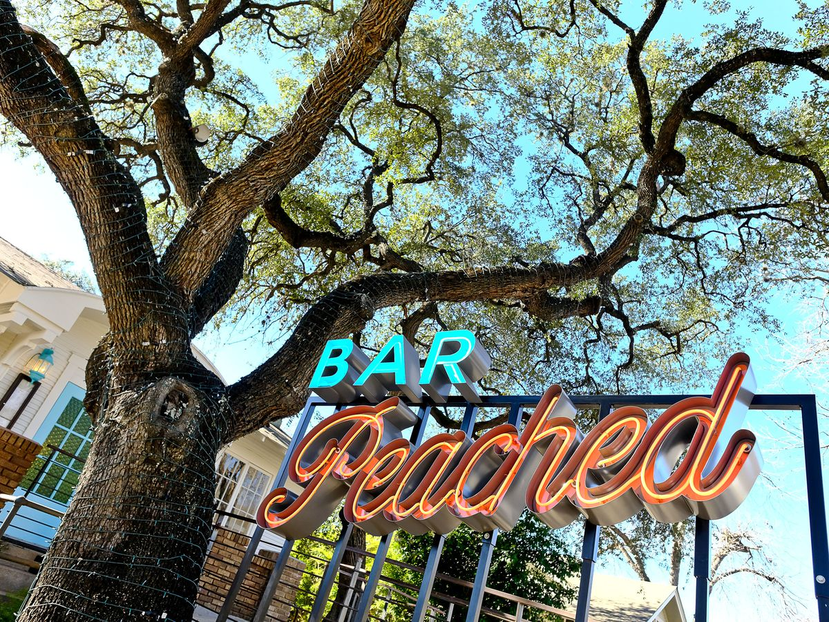 Bar Peached's neon sign