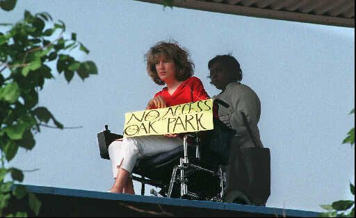 A women at a protest for CTA station accessibility in 1996 at the Oak Park Green Line station. The station is part of phase three of a new program to make every CTA rail station accessible by 2038. | Sun-times file photo