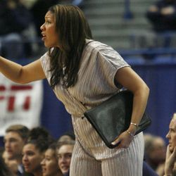 UConn assistant coach Marisa Moseley yells out instructions during the Notre Dame Fighting Irish vs UConn Huskies women's college basketball game in the Women's Jimmy V Classic at the XL Center in Hartford, CT on December 3, 2017.