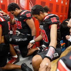 West High players pray before a high school football game against Roy High on Friday, Sept. 10, 2021, at West High School in Salt Lake City.
