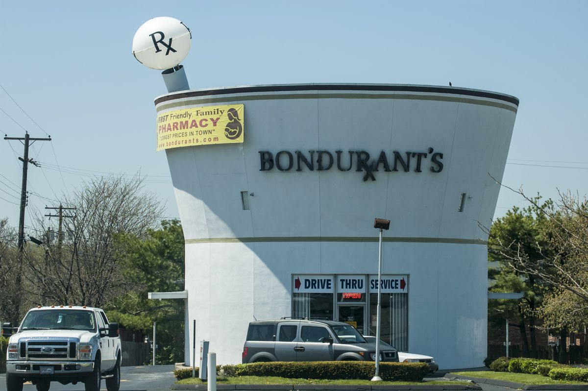 The exterior of Bondurant's Pharmacy in Kentucky.  The building is shaped like a mortar and pestle. There is a sign on the facade that reads: Bondurant's.