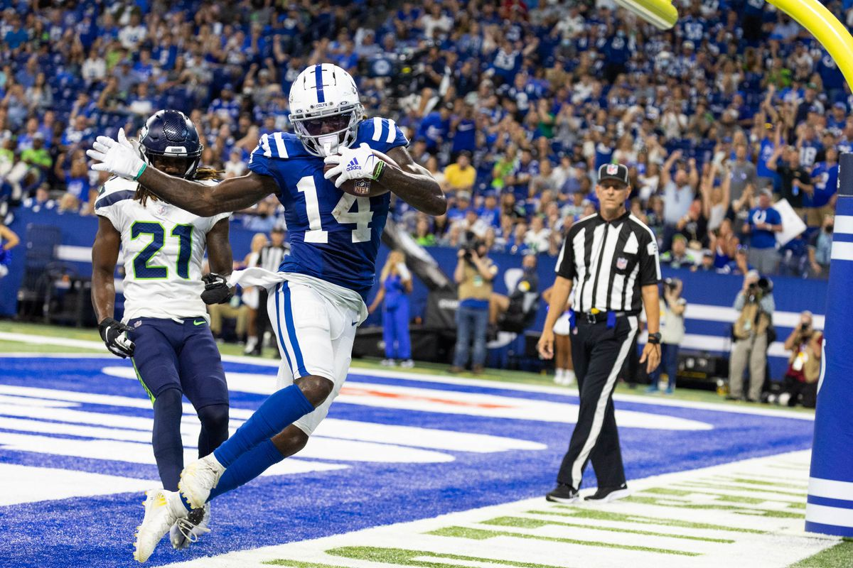 Indianapolis Colts wide receiver Zach Pascal (14) catches a touchdown pass while Seattle Seahawks cornerback Tre Flowers (21) defends in the second half at Lucas Oil Stadium.