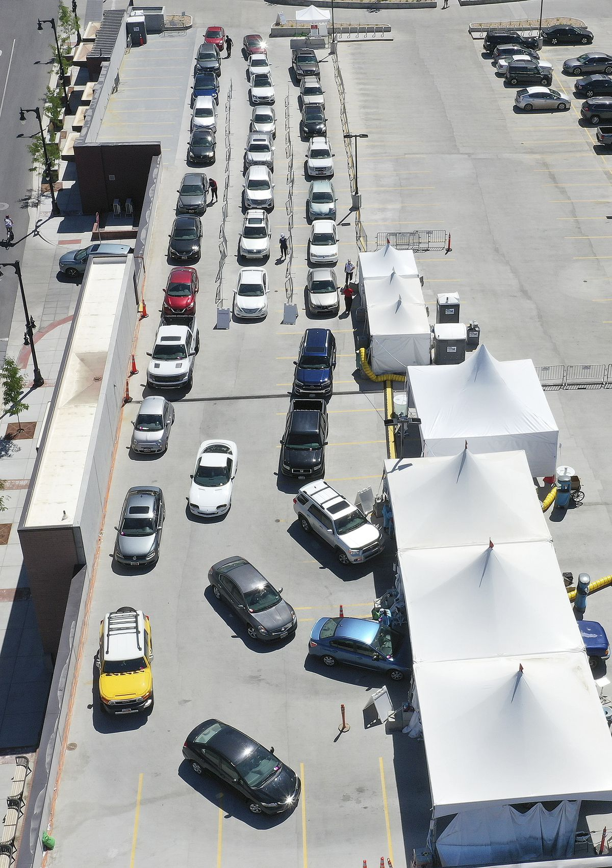 Numerous motorists line up for COVID-19 testing near University of Utah Health's Sugar House Health Center in Salt Lake City on Saturday, July 11, 2020.