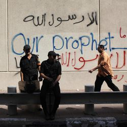 Egyptian soldiers stand guard in front of the U.S. embassy in Cairo, Egypt, Wednesday, Sept. 12, 2012.