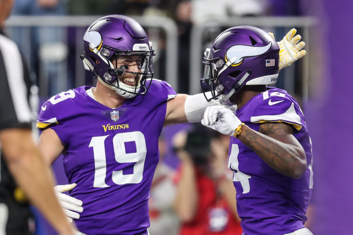 Minnesota Vikings wide receiver Stefon Diggs celebrates his touchdown with wide receiver Adam Thielen during the first quarter against the New Orleans Saints at U.S. Bank Stadium.