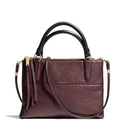 """<a href=""""http://f.curbed.cc/f/Coach_SP_102413_miniborough"""">The mini borough bag</a> in pebbled leather, $378"""