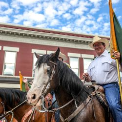 A member of the Utah County Sheriff Mounted Posse rides during the Grand Parade in Provo on Monday, July 5, 2021.