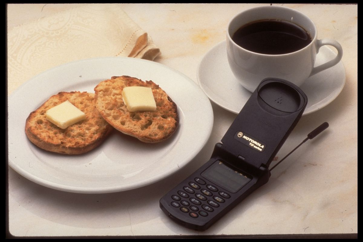 Cell phone, toasted english muffin and b