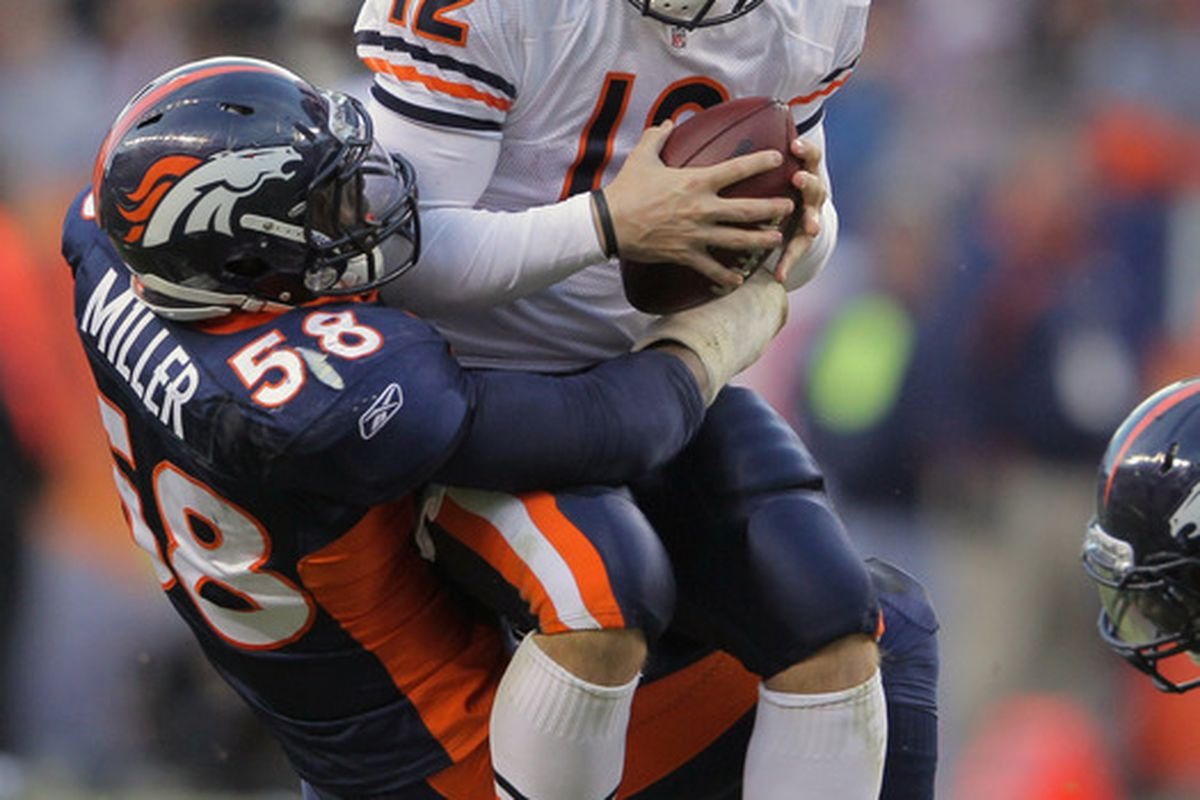 QB Caleb Hanie of the Chicago Bears is Sacked by LB Von Miller of the Denver Broncos on December 11, 2011 in Denver. The Broncos defeated the Bears 13-10 in overtime.  (Photo by Doug Pensinger/Getty Images)