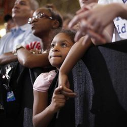 A young supporter listen to President Barack Obama speak at a campaign event at Bowling Green State University, Wednesday, Sept. 26, 2012, in Bowling Green, Ohio.
